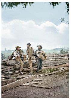 Colorized Version of Three captured Confederate soldiers, likely from Louisiana, pose for Mathew Brady on Seminary Ridge following the Battle of Gettysburg.