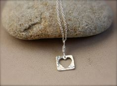 A little something different, but still with a heart shape. Small Heart, sterling silver necklace. Hammer texture, Little Heart. Etsy: KittyStoykovich