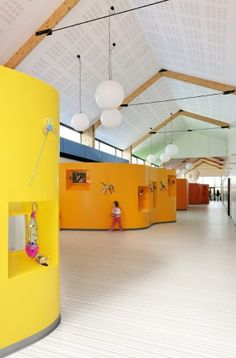 "The Children's Recreation Centre by AIR Architecture uses internal room modules to break down the larger central space into activity ""hubs""."