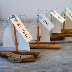 Driftwood boat wedding favours/place names. Handmade by Coastalcreatives. Name card and twine available in various colours to compliment your theme.
