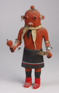 152: Mid 20th c. Hopi Mudhead kachina doll : Mid 20th century Hopi Koyemsi or Mudhead kachina doll, carved from cottonwood and hand painted, depicted with the red mud mask, feathers, and holding a rattle, a clown depicted in many ceremonies as a music maker or announcer.