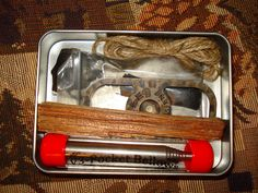 A Larger Tin with a nice little kit, with room to spare. Pocket bellows, ESEE fire steel, jute twine, flint, fatwood, and some char cloth:
