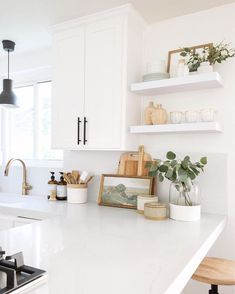 cottage kitchen design, white kitchen with white kitchen cabinets and marble counter with kitchen open shelf decor and black pendant light, eat in bar at traditional kitchen design, modern farmhouse kitchen White Kitchen Cabinets, Kitchen Countertops, Kitchen Units, White Kitchen Faucet, White Countertops, Oak Cabinets, Concrete Countertops, Kitchen Reno, Cupboards