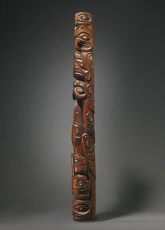 NORTHWEST COAST MODEL WOOD TOTEM POLE tapering form with deeply hollowed back, carved at the base with an unidentified creature, with thick lips, flaring nostrils, and exaggerated eye sockets flanking a stylized formline element, surmounted by a series of totemic creatures including a killer whale with a tall dorsal fin, a raven with backswept wings, a bear and an eagle with sharply downward turning beak, decorated with abalone shell. 42 1/2 in. Est 40,000 — 60,000 Lot 7 Sotheby's May 2014