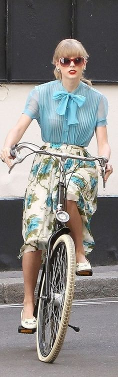 Taylor Swift in a charming dress in retro style, rolled through Paris on a bicycle