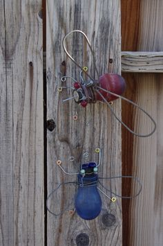 Bottle bugs recycled yard art. These were made using old humming bird feeders and some odds and ends from the toolbox as well as my jewelry box.