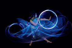 Luma Flow Spins Oceanic Light Trails. Luma spins up a beautiful ocean of amazing LED hooping light trails. Photo by Mike Laverdure Photography.