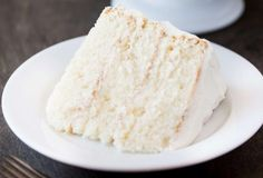 This doctored up version of a white cake mix is incredibly moist. There's milk, buttermilk, and sour cream in there which makes it more dense, like a homemade cake should be. Bakery Style Cake, Bakery Cakes, Bakery Box, Box Cake Recipes, Dessert Recipes, Easy Recipes, White Cake Box Recipe, Bakery White Cake Recipe, White Almond Cakes