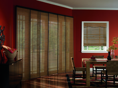 Sliding panels are a versatile choice to cover a large window.  With a wide variety of fabric choices, they can help coordinate any room!