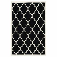 Flatweave wool and cotton rug with a trellis motif. Handmade in India.  Product: RugConstruction Material: Wool and cottonColor: Black and ivoryFeatures:  Made in India  Hand-woven Note: Please be aware that actual colors may vary from those shown on your screen. Accent rugs may also not show the entire pattern that the corresponding area rugs have.Cleaning and Care: Professional cleaning recommended