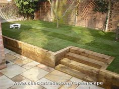 Retaining sleeper walls, steps, new fence, lawn and patio.