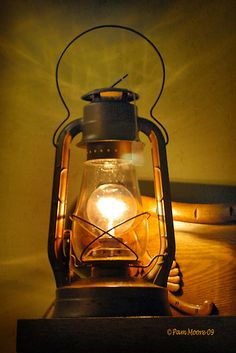 Two of these in an electric version to hang from either side of his bed. old lantern