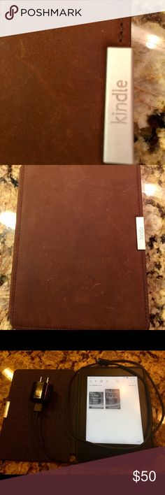 Paperwhite Kindle Comes with premium leather cover and cord.  Purchased around a year ago. Accessories