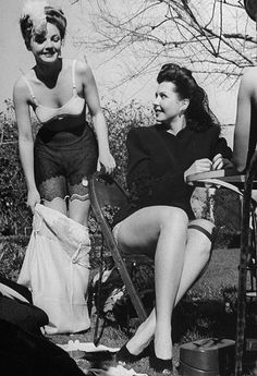 Anne Baxter and Ann Miller during a strip poker game held to raise clothing for a UNRRA drive, 1945