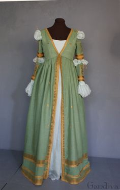 Period: around AD 1500, Italy. The green Renaissance dress features a deeper V-neck than the others. its front edges and hem are ornamented with woven gold braid.