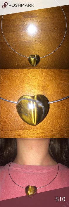 Metal Necklace with Heart Pendent Metal circular necklace with magnetic clasp. Brown heart shaped pendent. Never worn. Jewelry Necklaces