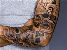 mulitiple skulls tattoo sleeve | to update your look, this Skull LA Ink Tattoo Designs On Sleeve ...