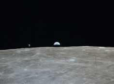 """The Apollo 16 Command """"Casper"""" and its Service Module are photographed in lunar orbit, along with an Earthrise, from the Lunar Module """"Orion"""" prior to descent to the lunar surface. Image rendered from a frame in Hasselblad magazine 113/A. April, 1972. Crop of image AS16-113-18288, scan courtesy NASA/JSC."""