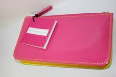 "Bare Escentuals Multicolor Cosmetic Bag by Bare Escentuals. $9.00. Has zippered top closure .. Bag measures approximately 6"" X 3 1/4"" X 3/4"".  One side is bright pink, the other side is bright green and the middle is bright yellow."
