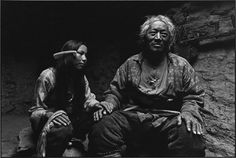 Magnum Photos -TIBET. Xigaze, about 300 Km west of Lhasa, in the Himalaya Mountains. Grandfather and his granddaughter. 2001