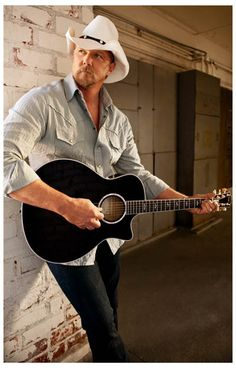 Country Music star Trace Adkins is Proud to Be Here and you'll be proud to have this poster on your wall! Ships fast. 11x17 inches. Scoot yer boots on over and check out the rest of our great selectio
