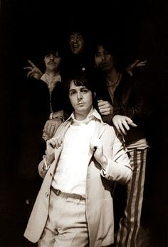 Pauly in the spotlight, ringo and George looking similarly confused and john is a ghost in the back. Priceless