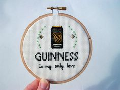 """Guinness is my only love -- completed cross stitch in 4"""" embroidery hoop with can of beer and flourishes"""