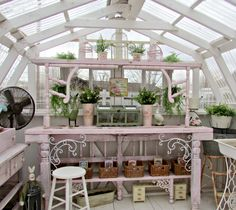 Penny's Vintage Home: We Built a Greenhouse I love the use of chair arms for decorative touch.
