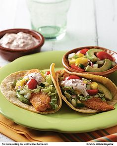 Fish Tacos (tilapia) | Cuisine at home eRecipes.  These are baked, not fried.  I've made them several times - really good.