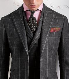 Ooh. Very nice. Can't say I care for the odd pattern in the tie but it is worn well and complements the otherwise alluring lines of the lapels quite well.