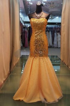 Elegant Evening Dresses / Sexy tight-fitting gold sequined elegant evening dresses / http://www.thdress.com/Sexy-tight-fitting-gold-sequined-elegant-evening-dresses-p461.html