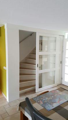 Schuifdeur voor trap gat.
