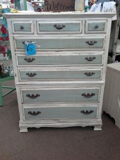 SOLD - This is a solid wood 8 drawer tall boy chest of drawers.  It has been painted, lightly distressed and finished with a tinted wax.  It measures 37 inches across the front, 18 inches deep and it stands 48 inches tall. It can be seen in booth A8 at Main Street Antique Mall 7260 East Main St ( E of Power Rd ) Mesa 85207  (contact info hidden) open 7 days 10 till 530  Cash or charge 30 day layaway also available