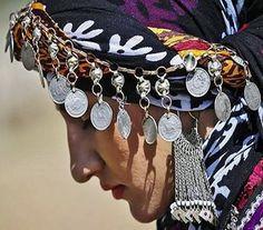 Festive headgear from Iranian Kurdistan.  Silk headscarves and silver jewelry.  Late 20th century.