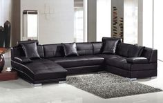 Awesome Living Room Set with White Wall Paint Color and Gray Square Shaped Fur Carpet Area also L Shaped Black Leather Sofa Completed and Small Black Pillows Idea