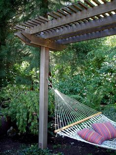 I wonder if I could grow wisteria on the arbor... If I succeeded my hammock would probably be infested with bees...