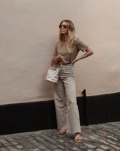 Chic neutral beige street style outfit  #neutraloutfit #neutralstyle #beigeoutfit #jeansoutfit #streetstyle #ootd #summeroutfit #casualstyle #neutralaesthetic #beigeaesthetic #basicstyle