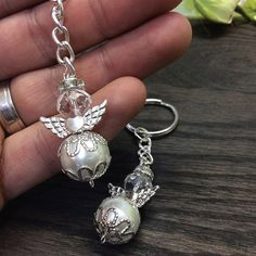 Items similar to 55 pcs Angel keychain/christening favor/baptism angel favor/baptism favors/recuerdo de bautizo/keychain, pearl keychain, angel keychain on Etsy Wire Jewelry, Jewelry Crafts, Beaded Jewelry, Jewelery, Handmade Jewelry, Christening Favors, Baptism Favors, Beaded Angels, Silver Wings
