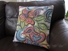 another example of doodling with sharpies and fabric paint on plain muslin and then adding stitching to make a pillow cover.  nice!