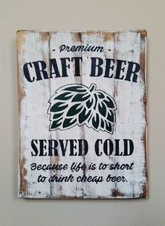 Handmade Craft Beer Served Cold Recycled Wood Sign Express your love for a quality brew with this wood craft beer sign. Perfect for a bar, man cave, kitchen or anywhere a fine hoppy beverage may be consumed. • Approximate dimensions: 18 tall x 14 wide • Naturally distressed wood