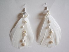 Ivory Feather Earrings - Pearl Earrings - Feather and Pearl Earrings - Bridal Earrings. $14.95, via Etsy.