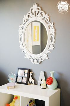 Ikea mirror.  Comes in black so it would need to be painted - we could paint it gold!