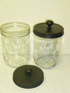 Awesome! Use any old glass jar with a lid (like mayo jars, pickle jars, you name it), glue on a knob, spray paint and voila! Stencil and spray frost