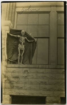 """""""John"""" Vintage photo of person in skeleton suit on a ledge"""