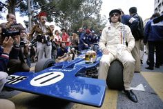 Jackie Stewart of Great Britain sits on the wheel of his Elf Team Tyrrell Tyrrell 003 Ford Cosworth DFV before the start of the Grand Prix of Monaco...