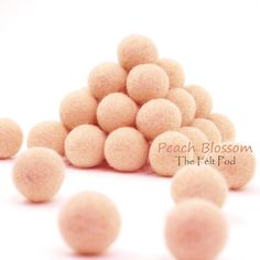 Color: Peach Blossom Sizes Available : 1.0 cm, 1.5 cm, 2.0 cm, 2.5 cm, 3.0 cm, 4.0 cm Qty: Ranges from 10 to 100 balls based on chosen ball size  [ This felt ball color is close to our Merino Wool Felt color Peach Blossom but it is produced in a different facility so slight color variation is possible. ]  These felt balls are just absolutely beautiful! They are by far much more uniform in size and color than other felt balls that we have come across. Of course, slight differences in size and…