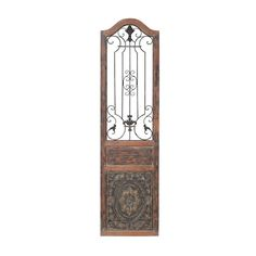 This enchanting iron fence wall decor is sure to capture compliments. Iron fence work is curled into floral ornamentals, and is set inside an aged copper-colored wood door panel. Bottom half of door panel is raised with mysterious iron floral emblem.