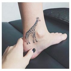 10 adorable, minimal animal tattoos that will inspire you to get inked, like this ankle giraffe tattoo.