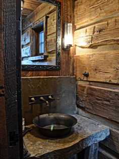 Rustic Bathroom Design - I love the big stone slab counter, and the simple faucets out of the backsplash. Highline Partners Montana