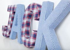 Blue Gingham Fabric Wall Letters. These sturdy letters have hooks on the back ready for hanging.